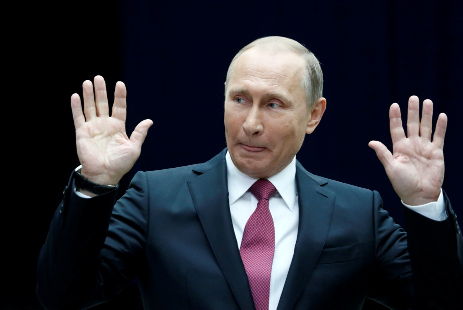 Russian President Putin gestures as he speaks to journalists following a live nationwide broadcast call-in in Moscow
